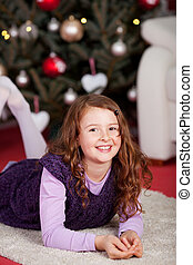 Little girl waiting for the Christ Child - Cute happy...