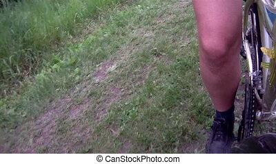 Time lapse women's leg twisting pedal bike
