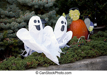 Pair of merry ghosts - Halloween decoration with pumpkin and...