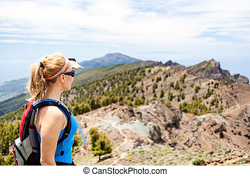 Hiking woman, runner in summer mountains