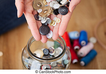 Designer'S Hands Filling Glass Jar In Workshop - Closeup of...