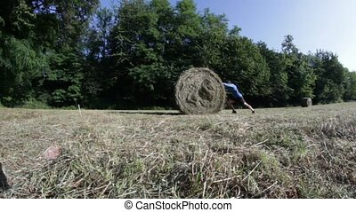 man and hay bale