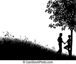 In the meadow - Editable vector silhouette of a young couple...