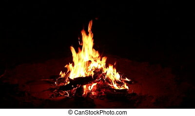 Nighttime campfire - Outdoor wood campfire burring brightly...