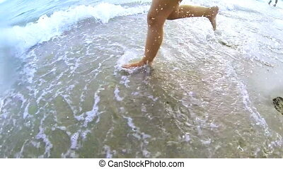 Kid running in the ocean
