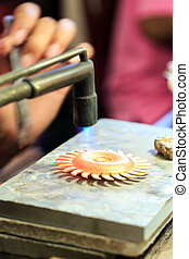 Goldsmith working with a thai traditional gold