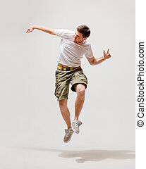 male dancer jumping in the air - picture of male dancer...
