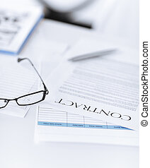 signed contract paper with glasses - picture of signed...