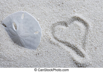 heart drawn in sand with copy space