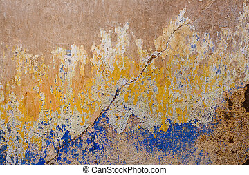 Old Stucco wall - Old decayed blue and yellow concrete wall...