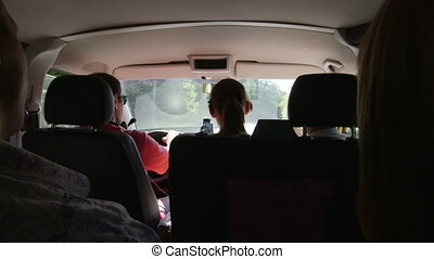 Driving minivan - A group of tourists in a minibus traveling...