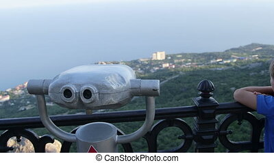 Binocular tower viewer in observation deck overlooking the...