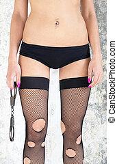Girl in underwear - The girl dressed in underwear holds...