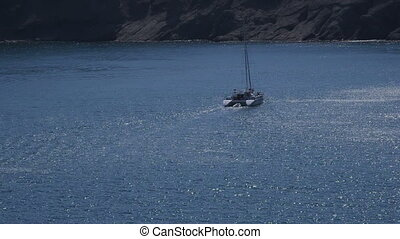 Catamaran sails on the Blue bay. Blue Bay also known as...