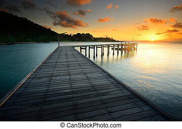 The beautiful wooden bridge with sunrise at national park Khao L