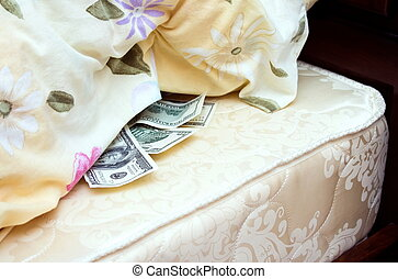 Money tucked away under a pillow