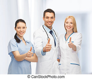 professional young team or group of doctors showing thumbs...