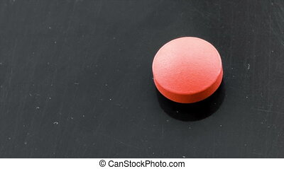 Pills - Medical pills placed on rotating table, shot with...
