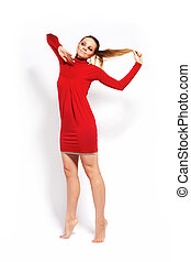 Fashion model on white studio background in red dress