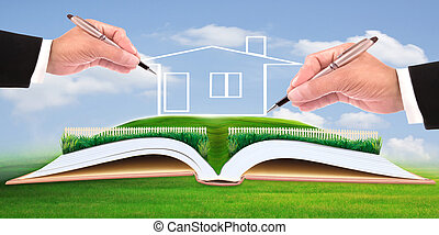 business man writing new house on beautiful green field use...