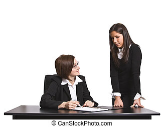 Working together - Two businesswomen discussing a file in...