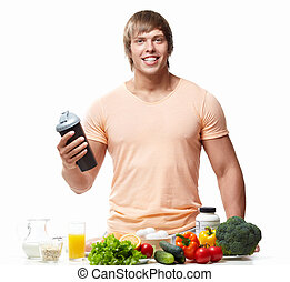 Athletic man with a shaker on white background