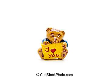 Teddy bear with love sign