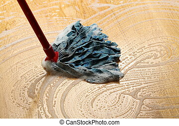 Cleaning wooden floor with mop, big housework