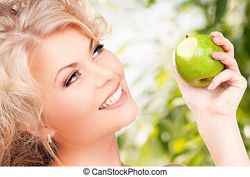 young beautiful woman with green apple - picture of young...