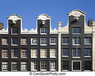 Amsterdam houses - Façade of canal houses in Amsterdam,...