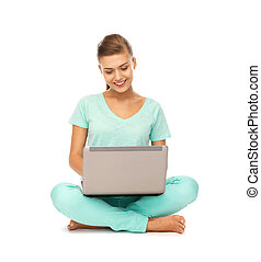 young girl sitting on the floor with laptop