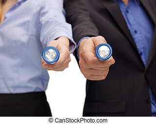 business team holding pocket flashlights - picture of...