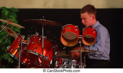 Boy Plays on Drum - boy playing drum set in the room on the...