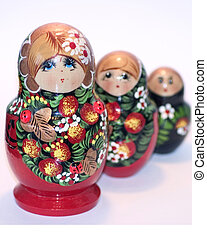 Russian dolls - A row of russian dolls on a white background