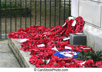 Poppy wreaths on war memorial - poppy wreaths on the war...