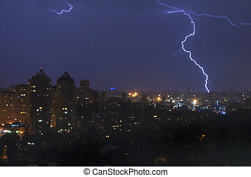 Lightening strikes a city at night in Kiev