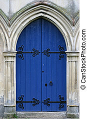 blue church door in stone archway - large wooden blue door...