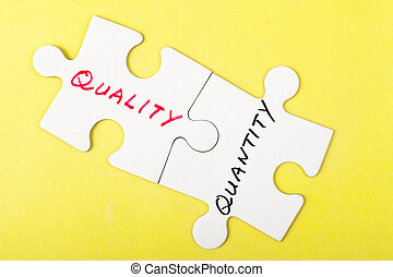 Quality or quantity - Quality and quantity words written on...
