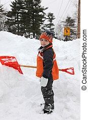 Snow Day - Adorable five year old boy shoveling snow.
