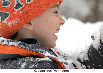 Snow Day - Adorable five year old boy playing in the snow.