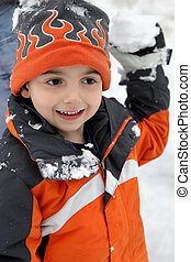 Snowball Fight - Adorable five year old getting ready to...