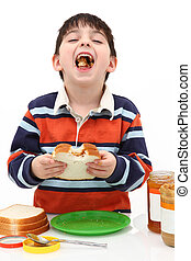 Peanut Butter and Jelly - Adorable five year old boy making...