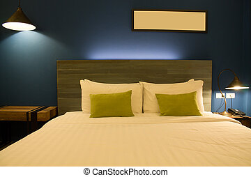 Bed room - Comfortable and serene bedside lit by lamp light