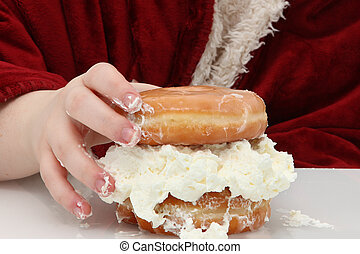 Doughnut Sandwhich - Teen girl hand on glazed donuts with...