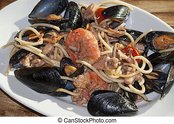 pasta allo scoglio - a traditional and typical Italian dish:...
