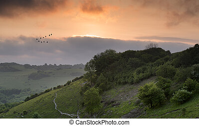 Vibrant sunrise over countryside landscape - Beautiful...