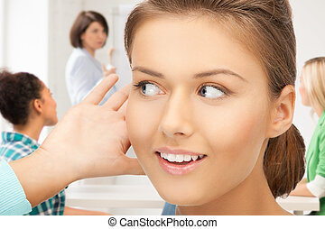 student girl listening gossip at school - young student girl...