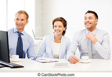 business team discussing something in office - smiling...
