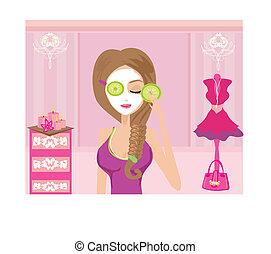 Cute girl applying moisturizer in elegant dressing room