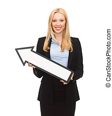 smiling businesswoman with direction arrow sign - picture of...